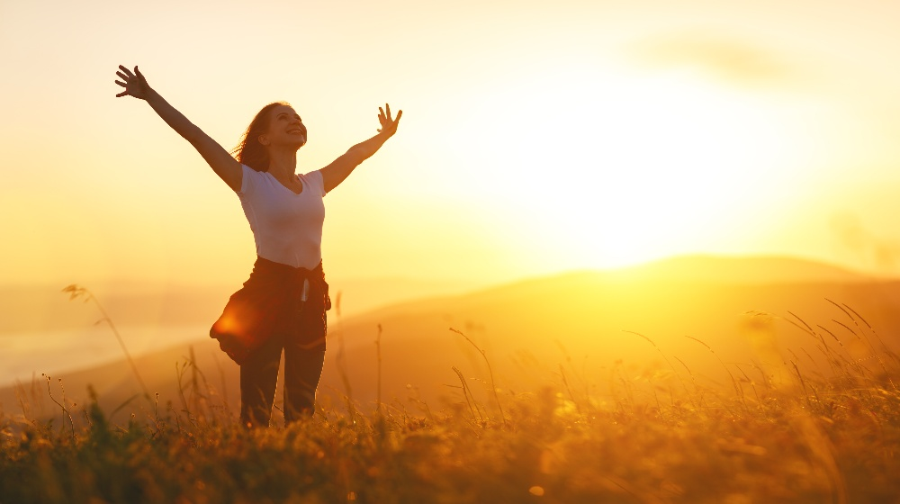 (new) healthy and happy women on the sunset in nature in summer with open hands