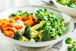 Vegan lunch bowl with brown rice, broccoli, sweet potato, and salad