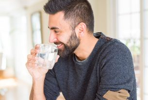 Happy man drinking water