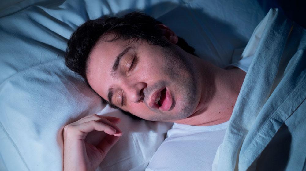 man-sound-asleep-snoring-in-bed-at-night-sleep-apnea